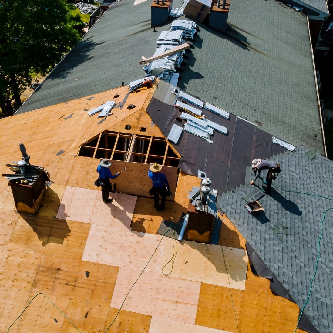 construction-worker-on-a-renovation-roof-the-house-installed-new-shingles_t20_xXRlPX
